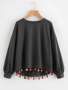 SheIn offers Colorful Tassel Trim Dip Hem Heathered Pullover   more to fit  your fashionable needs. f266d8277