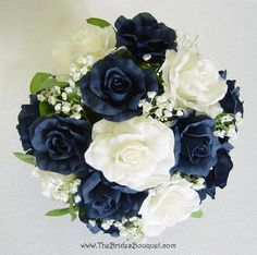 The navy blue silk rose collection was designed using deep, rich blue roses, the kind you can't find in nature. This nosegay blends open navy blue silk roses together with ivory silk roses, baby's bre