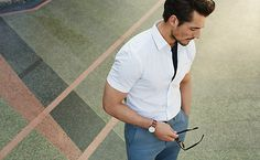 Man wearing white shirt and blue trousers
