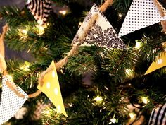 Love the idea of using bunting to decorate a tree, a mantel, a wreath, you name it. Green up this project by using found papers, boxes, and other unique items.