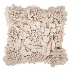Wool-cotton pillow covered in fabric rosettes.   Product: PillowConstruction Material: Wool-cotton blendColor: ParchmentFeatures:  Made in IndiaInsert includedZipper closure