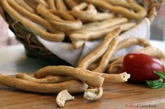One of the best snacks any Italian can have around the house are taralli, a crispy bread stick. At the store you'll usually find them in small circles flavoured with hot peppers, sun-dried tomatoes or fennel. My Calabrese side makes them