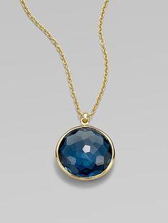 Ippolita 18K gold blue topaz pendant.