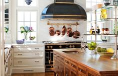 look at this gorgeous burl wood kitchen island - oh my! The Peak of Tres Chic Conservatory kitchen. This is my dream kitchen, except give me metal shelves to the right! Classic Kitchen, New Kitchen, Kitchen Dining, Kitchen Decor, Kitchen Cabinets, Kitchen Backsplash, Awesome Kitchen, Eclectic Kitchen, French Kitchen