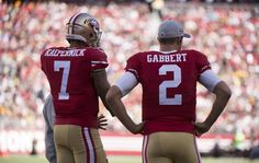 /San Francisco 49ers quarterback Colin Kaepernick (7) and quarterback Blaine Gabbert (2) stand near the team bench during a timeout in the fourth quarter in the NFL game between the San Francisco 49ers and Green Bay Packers on October 4, 2015 at Levi Stadium in Santa Clara.