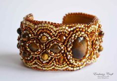 "Very rich gold and brown embroidered handmade cuff bracelet ""Ancient Treasure"" with genuine Tiger Eye cabochon. You can wear this unique cuff bracelet on any occasion. This beaded fashion bracelet is"