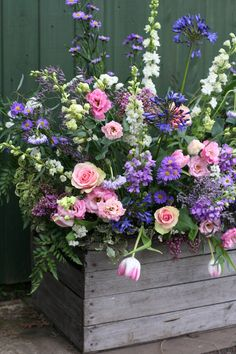 Spring flowers in a rustic vintage apple crate by Jenny Fleur