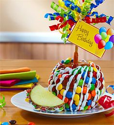 Make someone's birthday a deliciously big chocolate caramel apple day. This tart Granny Smith apple is over one pound, and dipped in creamy caramel, then sprinkled with milk chocolate rainbow candy and laced with white confection drizzle. Chocolate Apples, Big Chocolate, Chocolate Covered, Granny Smith, Gourmet Caramel Apples, Apple Caramel, Rainbow Candy, Caramel Candy, Apple Smoothies