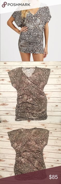 CARMEN MARC VALVO -Snakeskin print tunic / coverup NWOT- Never worn.  This stylish printed tunic has a flattering fit with side ruching.  Size is M/L but I'm more like a medium and it fits very nicely.  I'd keep this one but I have too many coverups.  Probably purchased this at Nordstrom.  Material is soft silky and stretchy. Carmen Marc Valvo Swim Coverups