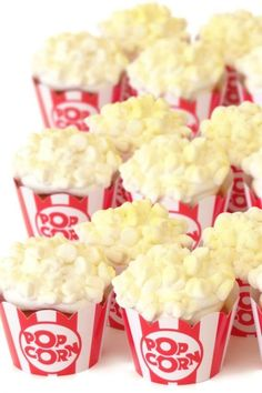 Everyone knows that popcorn and movies go hand in hand so how about treating your guests to some popcorn inspired cupcakes? Place your cupcakes in these popcorn box wrappers and top them with marshmallows to make them look like actual popcorn. You can bet they'll be a hit with your guests. See more party ideas and share yours at CatchMyParty.com #catchmyparty #partyideas #movienight #movienightparty #popcorncupcakes