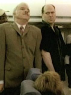 """Actor Marc Raco as a plane passenger is accosted by Inspector Clouseau (Steve Martin) in film """"The Pink Panther"""""""