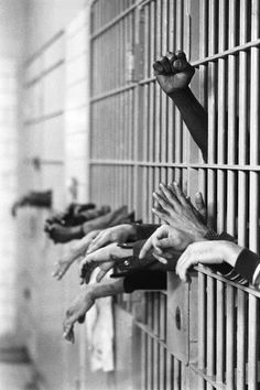 Photojournalism - A fist raised in protest from behind the bars at Toms Prison, Manhattan, on 28 September, Legendary photojournalist Jean-Pierre Laffont captured the changing times of New York City, covering everything from free love to the grim an Hand Photography, Street Photography, Landscape Photography, Portrait Photography, Travel Photography, Fashion Photography, Wedding Photography, Faust Goethe, Fotojournalismus