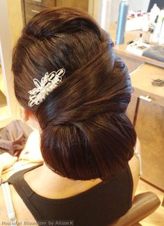 By Alison K. Bridal chignon by Alison with styling products by Aquage. @bloomdotcom