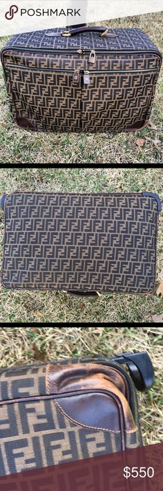 Authentic Fendi carry-on luggage travel bag authentic Fendi bag carry-on luggage with roller wheels condition seven of 10 slight fading on leather and scuffs see pics also zipper pulls are broken but do Come with bag and lock and key are intact. Zipper works but get stuck sometimes. Fendi Bags Travel Bags