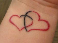 red hearts cross tattoo wrist