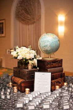 travel themed table with guest book and eiffel tower