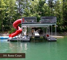 Host a friendly summer gathering or relax in the sun on the upper level of this two-slip boat dock. Have a splash on the attached slide or patter around on the water toys for a fun afternoon at the lake. Lake Dock, Boat Dock, Floating Dock, Lakefront Property, Lake Cabins, River House, Lake Life, Architecture, Dock Ideas