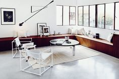 Minimalist living space with a bench doubling as seating