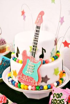 Awesome cake at a neon rockstar birthday party! See more party ideas at CatchMyParty.com!