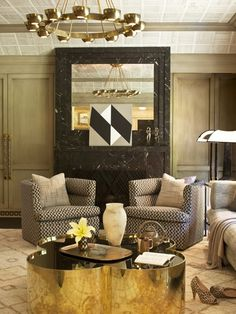 A gold quatrefoil-shaped coffee table adds an ultra-glam touch to this exquisite Wearstler project. The diamond rug pattern coordinates with the unusual fireplace grate and artwork.  Photo Gallery: Kelly Wearstler Designs | House  Home