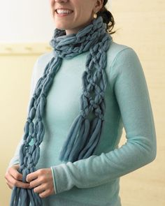 Whether you're an advanced knitter, a novice, or you've never even picked up a knitting needle, you can enjoy our favorite yarn projects. You'll find here a wonderful mix of knitted projects as well as plenty of no-knit ideas to make yarn crafts for your home and wardrobe.There's no knitting required to make this quick knotted-yarn scarf.