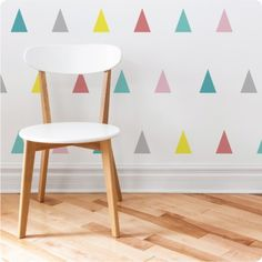 This pack of self adhesive triangles in these gorgeous colourways (or choose your own) are a great little gift, and a touch of colour for walls, doors, and furniture! CONTENTS: small pack: 37 triangles, 9cm high by 6.4cm wide, large pack: 18 triangles, 18cm high by 13cm wide COLOURS: Available in the colour options shown above, or choose up to 6 of your own colours from our Colour Chart to match your child's name. APPLICATION: The pieces are easily removed from the backing paper and placed…