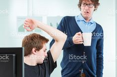 office colleague disgusted by body odour photo libre de droits