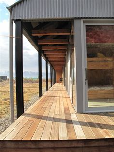 """Long """"corridor"""" hallways along east side of house. reminiscent of school camp, tramping huts etc. covered so can utilise in poor weather too."""