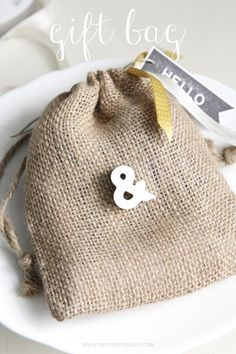 burlap bags with little letters- perfect gift idea.  www.inspirationave.com