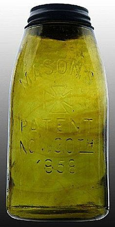 Mason's, Cross, Patent Nov 30th 1858, Olive Green, 12 Gallon.A half-gallon deep olive green Mason's Cross glass fruit or canning jar with amber striations