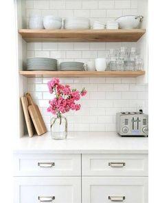 White kitchen cabinets, white worktop, white subway tiles and open wood shelves Kitchen Shelves, Diy Kitchen, Kitchen Dining, Kitchen Decor, Open Shelves, Kitchen White, Kitchen Ideas, Floating Shelves, Timber Shelves