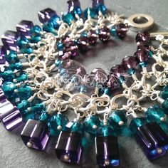 Stunning charm bracelet with 51 handmade wire wrapped glass charms in gorgeous rich purple and turquoise glass beads. A stunning statement on your wrist #FromTheAttic #HandMade #Accessories #Jewellery #Jewelry #Purple #Turquoise #Aquamarine #Bracelet #CharmBracelet #Charms #MadeInUK #Unique #Fashion #GiftsForHer