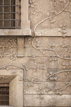 Close Up of Carved vine on exterior of building in the city, in Emilia Romagna: Reggio.