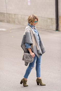 Seersucker and Saddles. Chambray shirt+ripped jeans+brown ankle boots+grey and nude poncho+grey shoulder bag+sunglasses. Fall Outfit 2016
