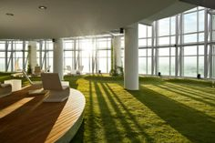 http://officesnapshots.com/2012/01/16/inspiration-cool-examples-of-offices-that-use-fake-grass/
