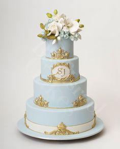 Ice blue and gold wedding cake with fresh white flowers as a perfect topper ~ Absolutely beautiful cake! | Ron Ben Israel...     ᘡղbᘠ