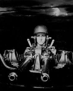 A PT boat gunner at his 50-cal machine gun New Guinea July 1943.