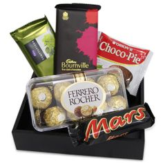 Gift your loved ones this charming Hamper which includes, 200gm Ferrero Rocher, 47gms mars, 72 gms temptation, 90 gms Bourneville and 30 gms choco pie in a 7×7 inch wooden tray.