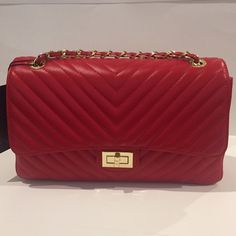 Made in Italy Quilted Chevron Leather Chain Bag Gorgeous nice quality bag. Red Italian leather made in Italy. Gold toned hardware. Classic chic style. Coated cloth interior.  28.5x16x8.5 cm. Bags Shoulder Bags