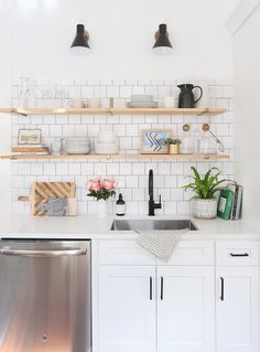 Scandinavian style kitchen tour: This white kitchen has a modern yet classic style with vintage flooring and rugs, as well as modern subway tile, white cabinets, and open shelving. Come explore this eclectic space with a full source list! White Kitchen Cabinets, Kitchen Shelves, Kitchen Tiles, Kitchen Flooring, Glass Shelves, Kitchen White, Upper Cabinets, Kitchen Modern, Wall Shelves