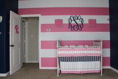 Pink and White Striped Accent Wall with Monogram - perfection in a baby girl nursery!