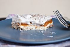 Pumpkin Lust Cake-buttery pecan crust, topped with a sweet cream cheese layer, the pumpkin pie pudding layer, and it's finished off with a layer of cool whip