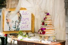 Baked cake with flower decor. Sophisticated dream wedding by the water with vintage chandeliers, hand-painted lampshades and period tablecloths