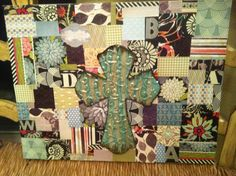 Just finished this for a housewarming present!  Scrapbook paper, modge podge, canvas and cross from Hobby Lobby!