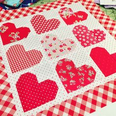 Finally putting the borders on this little mini.  Now to quilt it. #valentineday #valentine #hearts #miniquilt #red