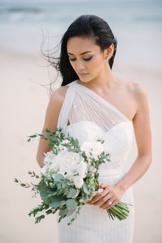 Sheer one-shoulder sash tulle wedding dress: Photography: darinimages - www.darinimages.com   Read More on SMP: http://www.stylemepretty.com/destination-weddings/2016/08/25/dreamy-beach-wedding-style-session-at-celebrity-destination/