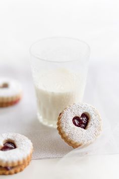 I like how the cookie is propped up against the glass of milk. The dessert looks very cute and dainty. Overall, good picture, but I think there's a little too much white; needs a bold background.