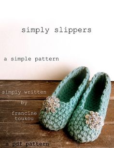 Ravelry: Simply Slippers pattern by fran toukou.  great pattern, simple and elegant.  I need those brooches!