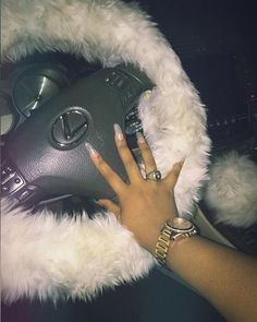 Cute nails, cute steering wheel cover, just girly things