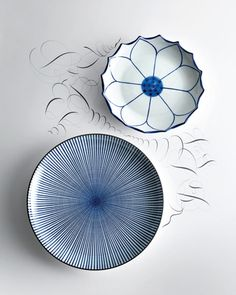 Lotus and Spoke plates from Elle Decor, December 2011.